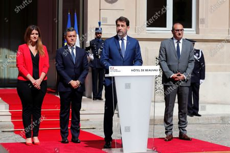 Outgoing French Interior Minister Christophe Castaner, center, delivers a speech flanked by newly appointed Interior Minister Gerald Darmanin, second from left, newly appointed deputy Minister in charge of Citizenship Marlene Schiappa, left, and Secretary of State to the Interior Minister Laurent Nunez, right, during the handover ceremony at the Interior Ministry, in Paris, . Former budget minister Darmanin was named to replace Interior Minister Christophe Castaner, who had come under fire amid widespread French protests against racial injustice and police brutality spurred by the death of George Floyd in the United States