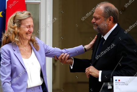 New Justice Minister Eric Dupond-Moretti (R) attends a handover ceremony with outgoing Justice Minister Nicole Belloubet (L) at the Ministry of Justice in Paris, France, 07 July 2020. Lawyer Dupond-Moretti has been appointed as the new Justice Minister after the government of Edouard Philippe had resigned on 03 July 2020, prompting a government and cabinet reshuffle.