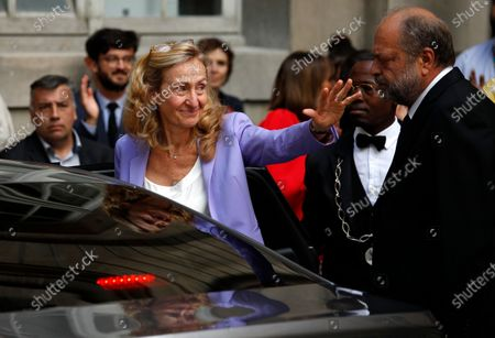 Outgoing Justice Minister Nicole Belloubet waves goodbye as she leaves after a handover ceremony with new Justice Minister Eric Dupond-Moretti (R) at the Ministry of Justice in Paris, France, 07 July 2020. Lawyer Dupond-Moretti has been appointed as the new Justice Minister after the government of Edouard Philippe had resigned on 03 July 2020, prompting a government and cabinet reshuffle.
