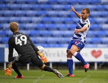 Madejski Stadium, Reading, Berkshire, England; the shot from George Puscas of Reading is saved by Jonas Lossl of Huddersfield; English Championship Football, Reading versus Huddersfield.
