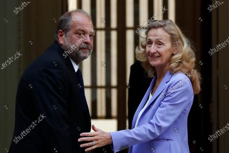 New French Justice Minister Eric Dupond-Moretti, left, arrives for a handover ceremony with outgoing Justice Minister Nicole Belloubet at the Ministry of Justice in Paris, France, . Lawyer Dupond-Moretti has been appointed as the new Justice Minister after the government of Edouard Philippe had resigned on July 3, 2020, prompting a government and cabinet reshuffle