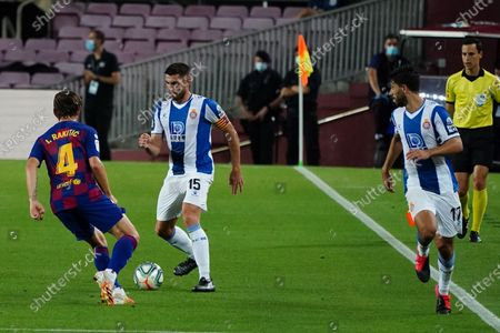 Camp Nou, Barcelona, Catalonia, Spain; David Lopez looks to lay off a pass under pressure by Rakitic of Barca; La Liga Football, Barcelona versus Espanyol.
