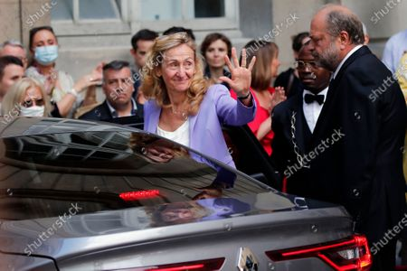Stock Photo of New French Justice Minister Eric Dupond-Moretti, right, looks at outgoing Justice Minister Nicole Belloubet waving to her staff as she enters her car after a handover ceremony at the Ministry of Justice in Paris, France, . Lawyer Dupond-Moretti has been appointed as the new Justice Minister after the government of Edouard Philippe had resigned on July 3, 2020, prompting a government and cabinet reshuffle