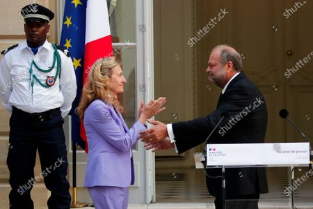 New French Justice Minister Eric Dupond-Moretti, right, greets outgoing Justice Minister Nicole Belloubet during a handover ceremony at the Ministry of Justice in Paris, France, . Lawyer Dupond-Moretti has been appointed as the new Justice Minister after the government of Edouard Philippe had resigned on July 3, 2020, prompting a government and cabinet reshuffle