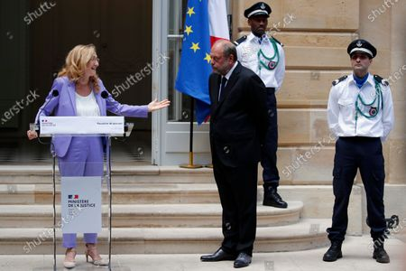 New French Justice Minister Eric Dupond-Moretti, right, attends for a handover ceremony with outgoing Justice Minister Nicole Belloubet, left, at the Ministry of Justice in Paris, France, . Lawyer Dupond-Moretti has been appointed as the new Justice Minister after the government of Edouard Philippe had resigned on July 3, 2020, prompting a government and cabinet reshuffle
