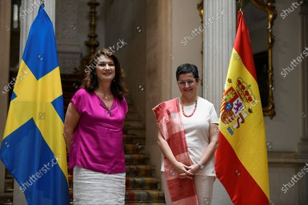 Spanish Foreign Affairs Minister, Arancha Gonzalez Laya (R), greets her Swedish counterpart, Ann Linde, shortly before holding a meeting in Madrid, Spain, 07 July 2020.