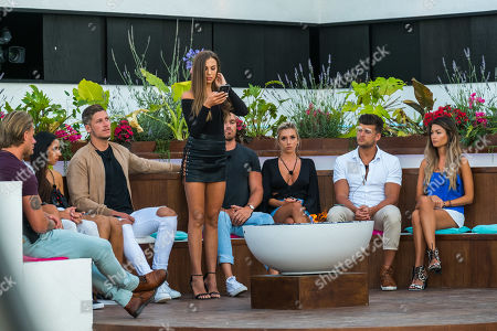 Stock Picture of The Islanders gather around fire pit to see who out of Cassidy McGill and Edyn Mackney is dumped from the Island