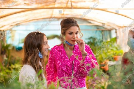 HRH Princess Iman bint Abdullah and HRH Queen Rania with face masks, in seed produce growing area