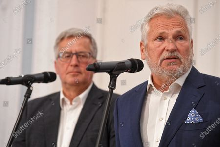 Former Polish Presidents Bronislaw Komorowski (L) and Aleksander Kwasniewski (R) attend a press conference before the second round of presidential election in Warsaw, Poland, 07 July 2020. The right-wing incumbent president and his main contender, the centrist Civic Coalition candidate will have a run-off in the second round of presidential elections on 12 July 2020.