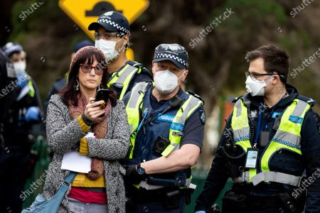 A women who was earlier arrested for disobeying police orders is released from custody as she live streams the incidents on her phone amid the third full day of the total lockdown of 9 housing commission high rise towers in North Melbourne and Flemington during COVID 19.After recording 191 COVID-19 cases overnight forcing Premier Daniel Andrews to announce today that all of metropolitan Melbourne along with one regional centre, Mitchell Shire will once more go back to stage three lockdowns from midnight Wednesday June 8. This comes as the residents of the housing commission towers in North Melbourne and Flemington finish their third day under extreme lockdown, despite only 27 cases being found in the towers. Members of the public gathered outside of the towers this afternoon in support of those trapped inside while riot police arrested two women for standing too close to the fence. While the women were later released, tensions are boiling over both in the towers and out. With 772 active cases in Victoria, NSW closed their border to Victoria effective at midnight tonight.