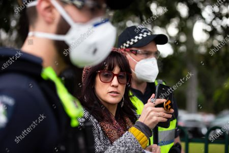 A member of the public standing in support of the residents inside 120 Racecourse Road is arrested as she live streams the incident on her phone amid the third full day of the total lockdown of 9 housing commission high rise towers in North Melbourne and Flemington during COVID 19.After recording 191 COVID-19 cases overnight forcing Premier Daniel Andrews to announce today that all of metropolitan Melbourne along with one regional centre, Mitchell Shire will once more go back to stage three lockdowns from midnight Wednesday June 8. This comes as the residents of the housing commission towers in North Melbourne and Flemington finish their third day under extreme lockdown, despite only 27 cases being found in the towers. Members of the public gathered outside of the towers this afternoon in support of those trapped inside while riot police arrested two women for standing too close to the fence. While the women were later released, tensions are boiling over both in the towers and out. With 772 active cases in Victoria, NSW closed their border to Victoria effective at midnight tonight.