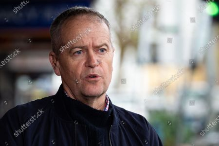 Ex Opposition Leader, Bill shorten speaks to the media as he prepares to assist in food deliveries to the Racecourse Road housing complexes amid the third full day of the total lockdown of 9 housing commission high rise towers in North Melbourne and Flemington during COVID 19.After recording 191 COVID-19 cases overnight forcing Premier Daniel Andrews to announce today that all of metropolitan Melbourne along with one regional centre, Mitchell Shire will once more go back to stage three lockdowns from midnight Wednesday June 8. This comes as the residents of the housing commission towers in North Melbourne and Flemington finish their third day under extreme lockdown, despite only 27 cases being found in the towers. Members of the public gathered outside of the towers this afternoon in support of those trapped inside while riot police arrested two women for standing too close to the fence. While the women were later released, tensions are boiling over both in the towers and out. With 772 active cases in Victoria, NSW closed their border to Victoria effective at midnight tonight.