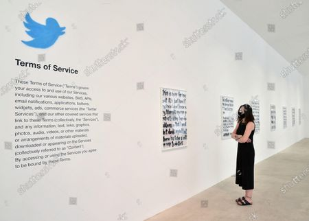 A visitor looks at artworks by Italian artist Woc (24) in the exibition 'Social Bloom' at Galleria Noir in Turin, Italy, 07 July 2020. The thirteen artworks are designed with spray whose subjects are seven tweets of US rapper Kanye West. Made on white wrapping paper with the spray technique, they are part of a larger artistic project that Woc dedicated a couple of years ago to West, the billionaire musician, stylist, record producer, also known for being Kim Kardashian's husband.