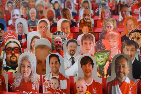 The image of English comedian and actor Ricky Gervais (C) amongst images of supporters in the stands ahead of the English Premier League match between Watford FC and Norwich City in Watford, Britain, 07 July 2020.