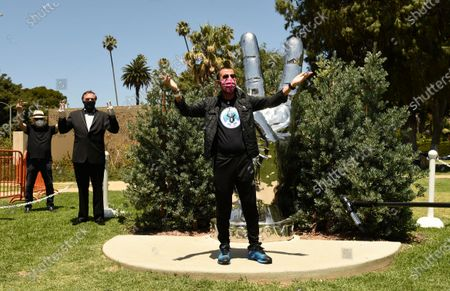 """Musician Ringo Starr poses in front of his """"Peace and Love"""" sculpture on his 80th birthday, in Beverly Hills, Calif"""
