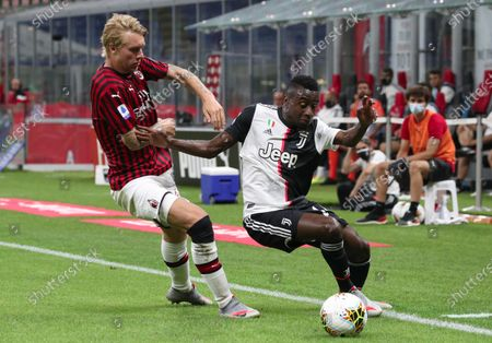 Juventus' mildfielder Blaise Matuidi and Ac Milan's defender Alexis Saelemaekers during the Italian Serie A soccer match between AC Milan and Juventus Turin at the Giuseppe Meazza Stadium in Milan, Italy, 07 July 2020.