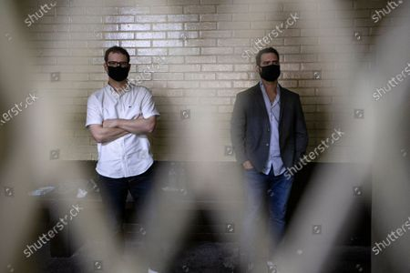 The sons of former Panamanian President Ricardo Martinelli, Ricardo Martinelli Linares, right, and his brother Luis Enrique stand inside a holding cell at the judicial court building in Guatemala City, . The brothers were detained Monday on an international warrant from Interpol on charges of conspiracy to commit money laundering