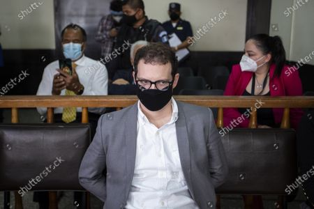 The son of former Panamanian President Ricardo Martinelli, Luis Enrique Martinelli Linares, waits for a hearing at the judicial court building in Guatemala City, . Luis Enrique and his brother Ricardo were detained Monday on an international warrant from Interpol on charges of conspiracy to commit money laundering