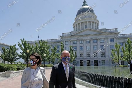 Lt. Gov Spencer Cox joined by his running mate Sen. Deidre Henderson, R-Spanish Fork, arrive for a press conference at the Utah State Capitol, in Salt Lake City. Jon Huntsman Jr. was narrowly beaten Monday, July 6, 2020, by Cox, who had heightened visibility as he helped respond to the coronavirus and managed to pitch himself as an earnest politician with rural Utah roots