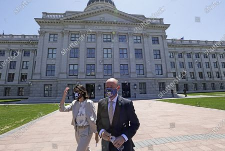 Stock Image of Lt. Gov Spencer Cox, center, joined by his running mate Sen. Deidre Henderson, R-Spanish Fork, arrive for a press conference at the Utah state Capitol, in Salt Lake City. Jon Huntsman Jr. was narrowly beaten Monday, July 6, 2020, by Cox, who had heightened visibility as he helped respond to the coronavirus and managed to pitch himself as an earnest politician with rural Utah roots