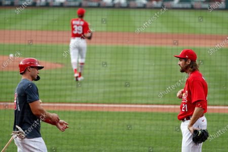 St. Louis Cardinals pitcher Andrew Miller, right, talks with Paul Goldschmidt during baseball practice at Busch Stadium, in St. Louis