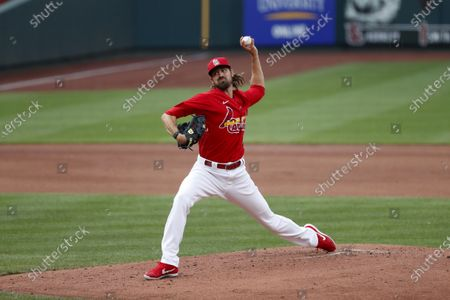St. Louis Cardinals pitcher Andrew Miller throws during baseball practice at Busch Stadium, in St. Louis