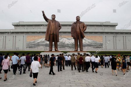 People visit the Mansu Hill to pay respects to the bronze statues of late leaders Kim Il Sung and Kim Jong Il on the occasion of the 26th anniversary of Kim Il Sung's death, in Pyongyang, North Korea