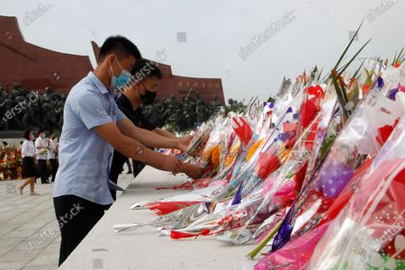 People visit the Mansu Hill to pay respects to the bronze statues of North Korean late leaders Kim Il Sung and Chairman Kim Jong Il on the occasion of the 26th anniversary of Kim Il Sung's death, in Pyongyang, North Korea