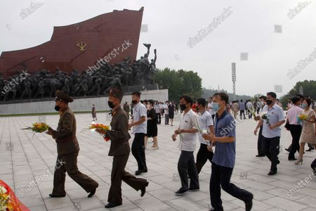 People visit the Mansu Hill to pay respects to the bronze statues of North Korean late leaders Kim Il Sung and Kim Jong Il on the occasion of the 26th anniversary of Kim Il Sung's death, in Pyongyang, North Korea