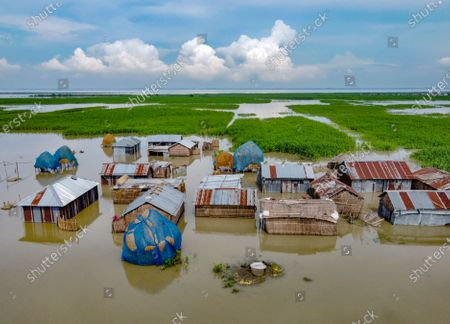 Way of life continues in village hit by floods, Bangladesh