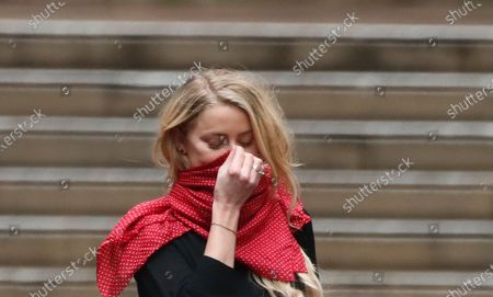 """Amber Heard departs the High Court in London, . Johnny Depp has denied an allegation by ex-wife Amber Heard that he is a """"Dr. Jekyll and Mr. Hyde"""" monster who turned violent when he drank and took drugs, though he acknowledged in a London court that he may have done things he can't remember while he was under the influence. Depp underwent a second day of cross-examination from a lawyer for British tabloid The Sun on Wednesday"""