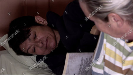 Ep 10091 Wednesday 22nd July 2020 Yasmeen Metcalfe's, as played by Shelley King, cell mate Lucie, as played by Nicola Duffett, gives her a book on coercive control.