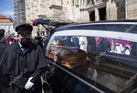 The coffin of deceased cleric Georg Ratzinger is carried after a requiem at the cathedral in Regensburg, Germany, 08 July 2020. Ratzinger, brother of Pope Emeritus Benedict XVI, has died aged 96 in Regensburg on 01 July 2020.