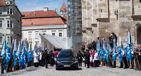 A hearse with the coffin of deceased cleric Georg Ratzinger leaves after a requiem at the cathedral in Regensburg, Germany, 08 July 2020. Ratzinger, brother of Pope Emeritus Benedict XVI, has died aged 96 in Regensburg on 01 July 2020.