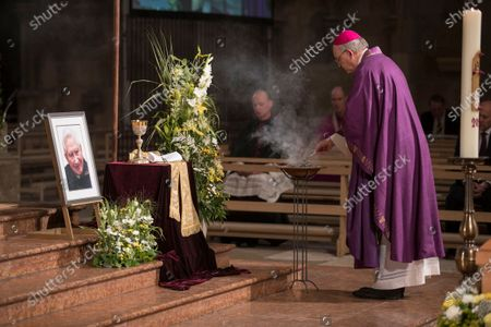 Stock Photo of The coffin of deceased cleric Georg Ratzinger is displayed during a requiem at the cathedral in Regensburg, Germany, 08 July 2020. Ratzinger, brother of Pope Emeritus Benedict XVI, has died aged 96 in Regensburg on 01 July 2020.