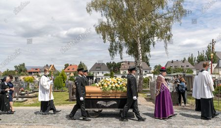 The coffin with deceased cleric Georg Ratzinger arrives at the catholic cemetery in Regensburg, Germany, 08 July 2020. Ratzinger, brother of Pope Emeritus Benedict XVI, has died aged 96 in Regensburg on 01 July 2020.