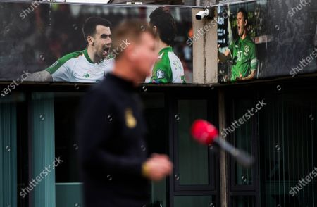 Seamus Coleman and Robbie Keane on a display as manager Stephen Kenny is interviewed