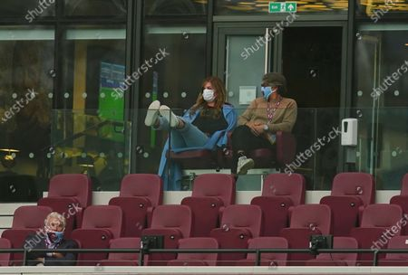 West Ham United Vice-Chair Karren Brady with her feet up alongside husband Paul Peschisolido