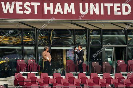 Jack Sullivan, son of West Ham Co-Owner David Sullivan, points upwards in the Directors' Box