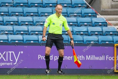 Assistant Referee Michael George during the EFL Sky Bet Championship match between Millwall and Middlesbrough at The Den, London