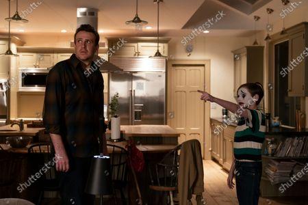 Jason Segel as Peter and Travis Burnett as Clown Boy