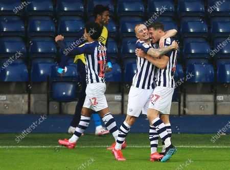 Dara O'Shea of West Bromwich Albion celebrates scoring a goal to make it 2-0 with Kamil Grosicki
