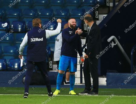 Wayne Rooney of Derby County with West Bromwich Albion manager Slaven Bilic at the end of the game