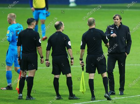 Derby County manager Phillip Cocu with the match officials at the end of the game
