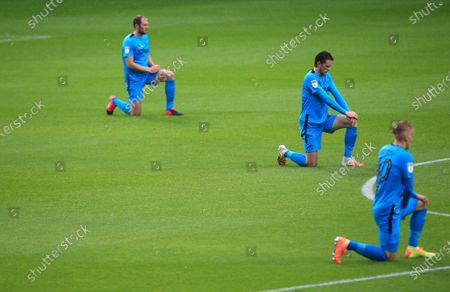 Derby County players take a knee ahead of the game