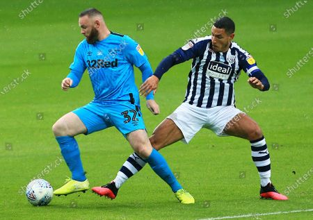 Wayne Rooney of Derby County and Jake Livermore of West Bromwich Albion
