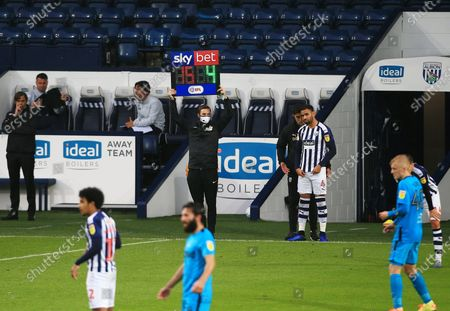 The fourth official holds up the digital display board