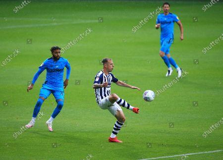 Kamil Grosicki of West Bromwich Albion and Jayden Bogle of Derby County