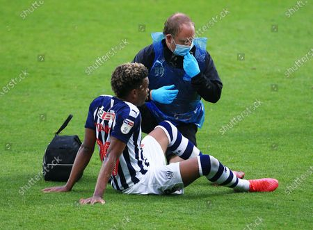 Grady Diangana of West Bromwich Albion receives treatment for an injury