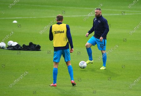 Wayne Rooney of Derby County warms up ahead of the game